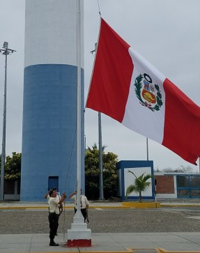 Raising the Peruvian flag at the border at 8am