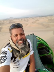 Sand surfing in the desert