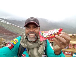 I just had to do it. Eat Skittles on Rainbow Mountain. Taste the rainbow.